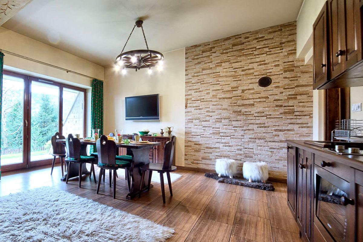 Salon w apartamencie - część wypoczynkowa i jadalniana